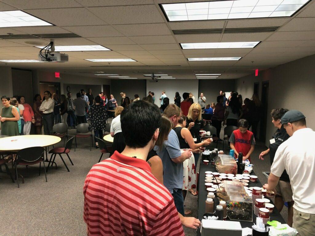 Departments of UniGroup enjoying ice cream sundaes in Fenton, Missouri