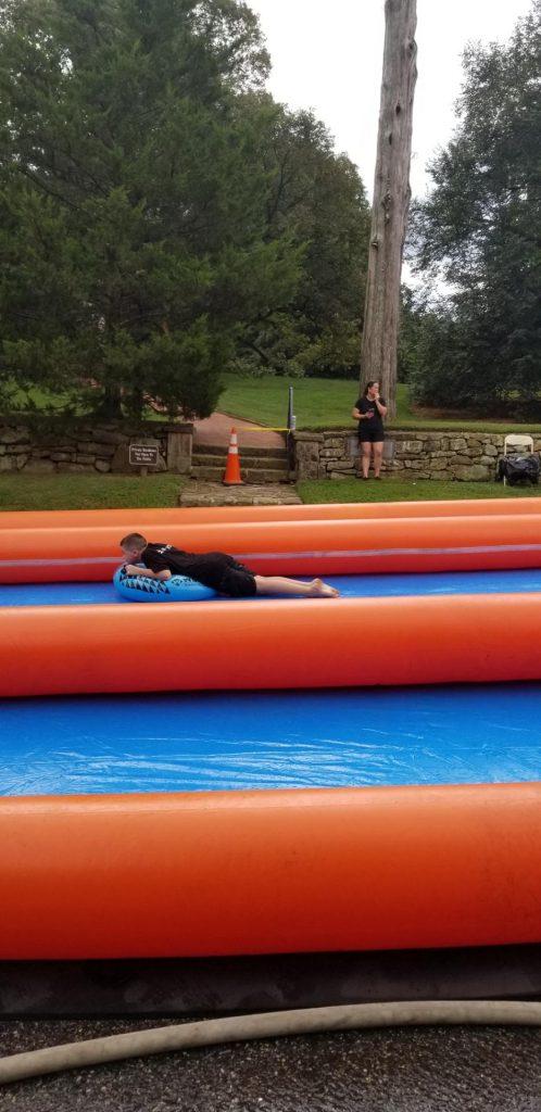 Child slides down slide