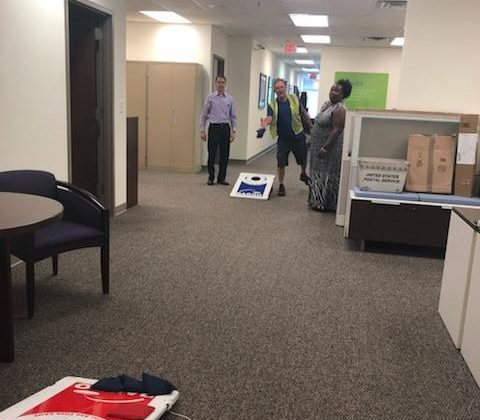 Hilldrup Atlanta employees play cornhole indoors