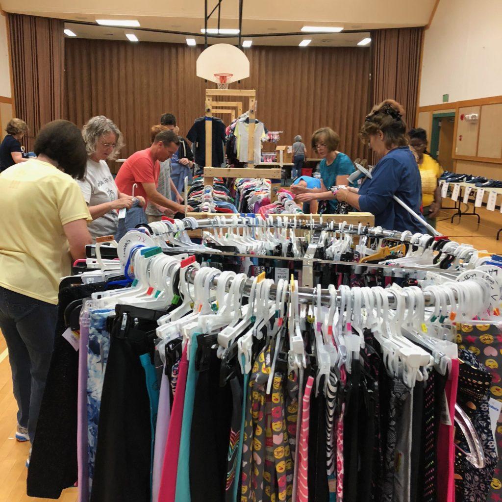 Clothes organized on racks