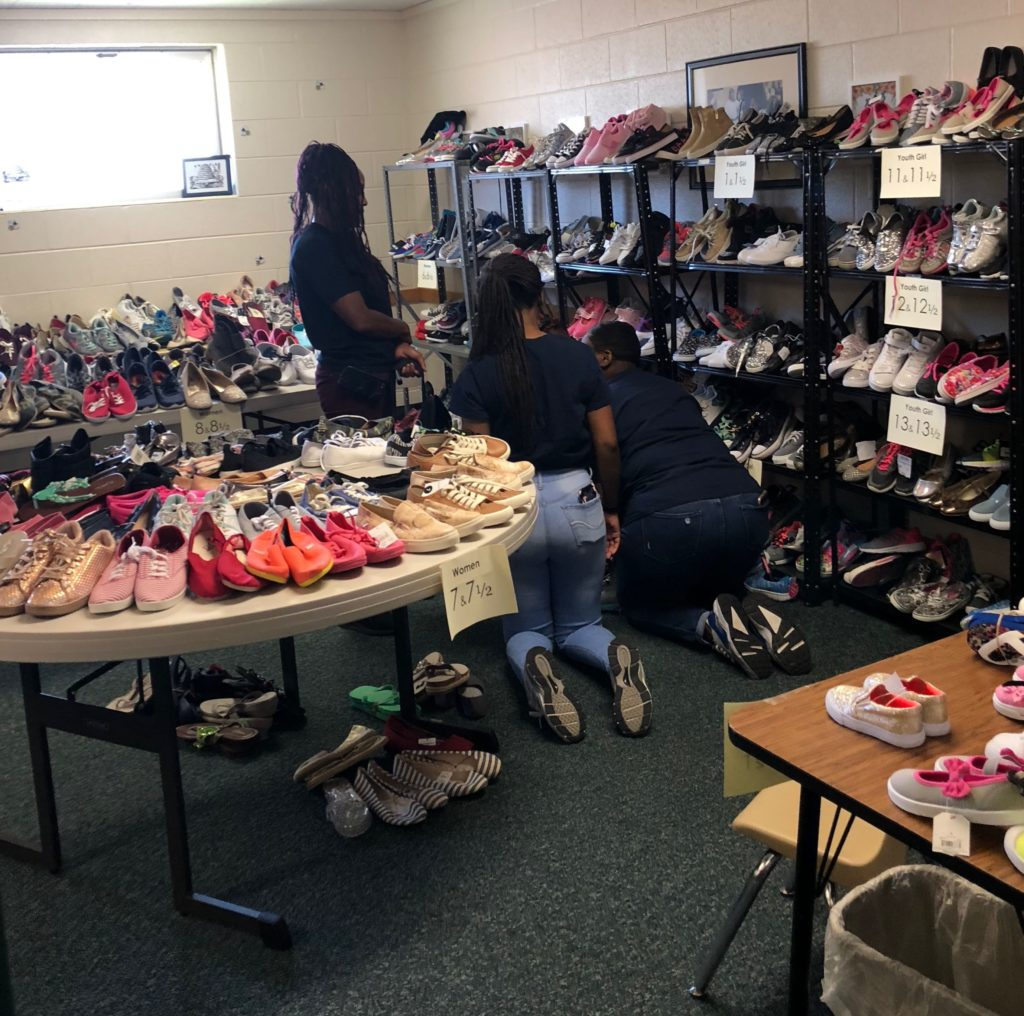 Shoe drive with shoes organized by size