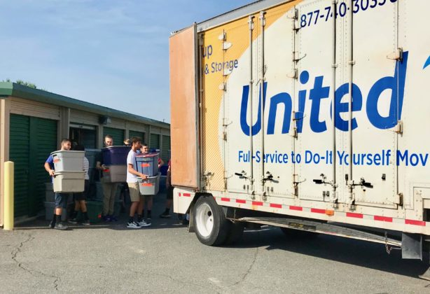 Young students load bins into Hilldrup truck