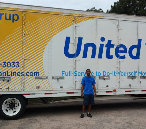 Hilldrup employee in front of truck