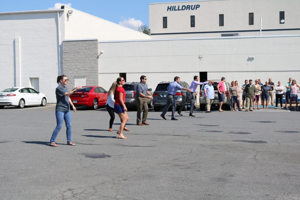 Hilldrup employees throw water balloons