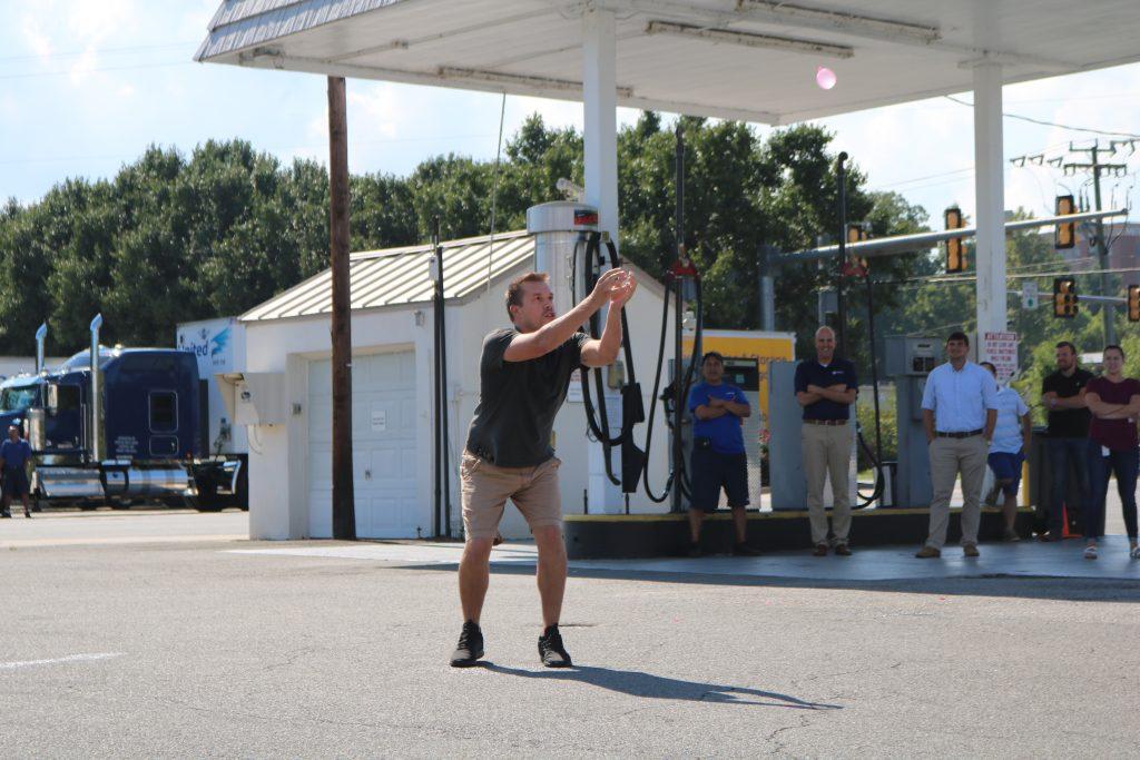 Eric Kristie prepares to catch water balloon
