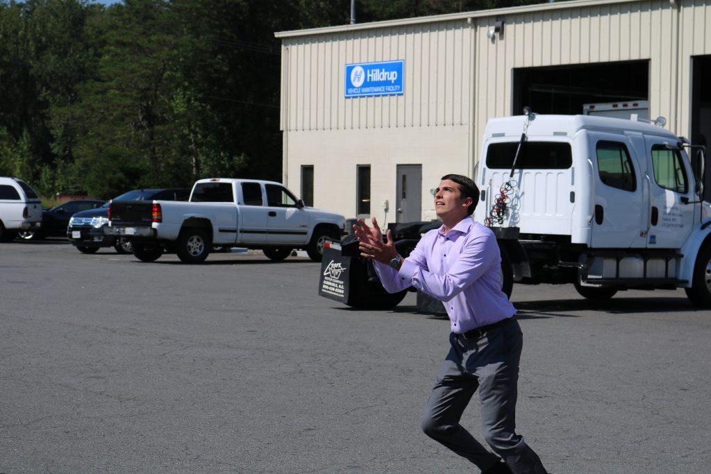 Charlie McDaniel catching water balloon