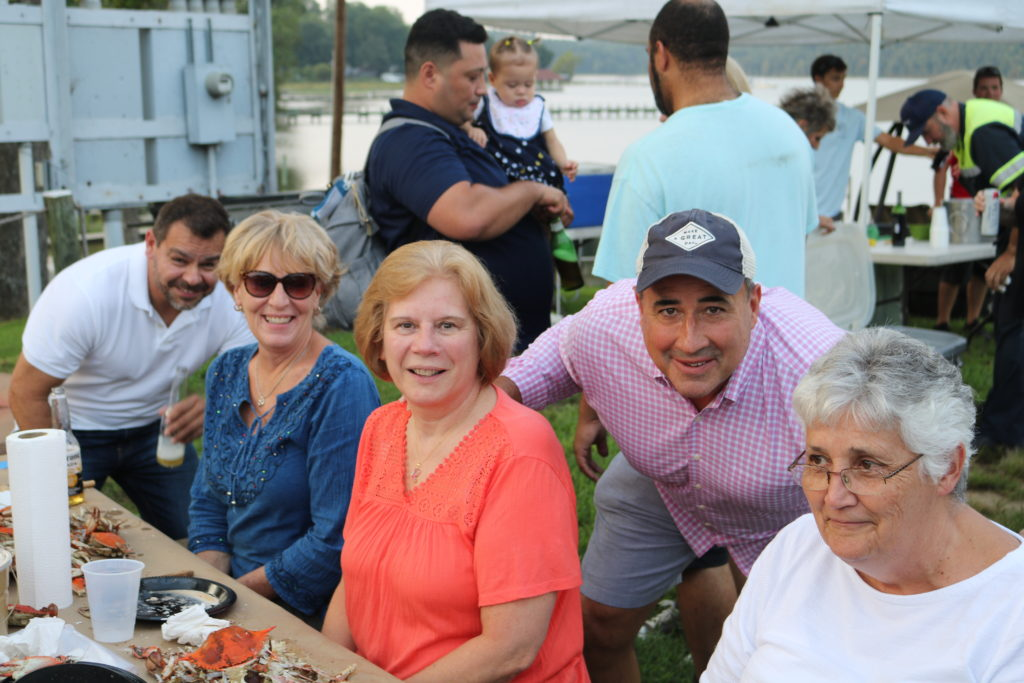 Hilldrup employees at picnic bench at crab feast