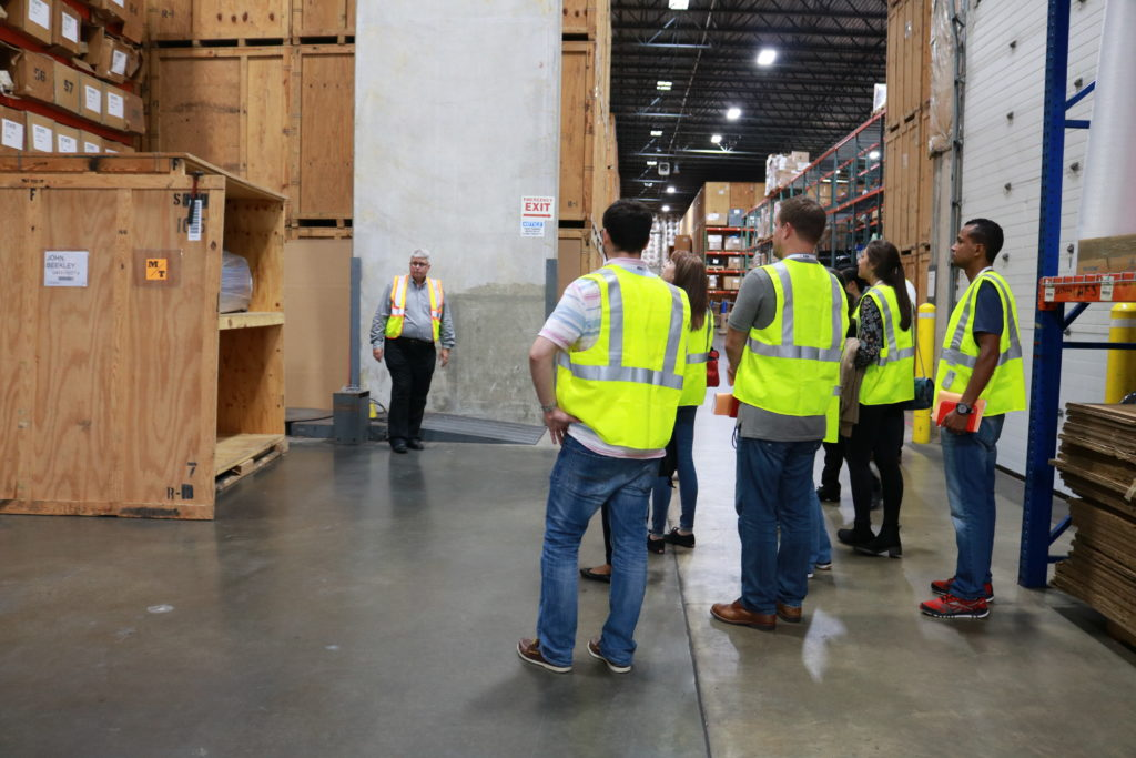 FIDI students receive a tour from VP/GM Rob Williams of warehouse