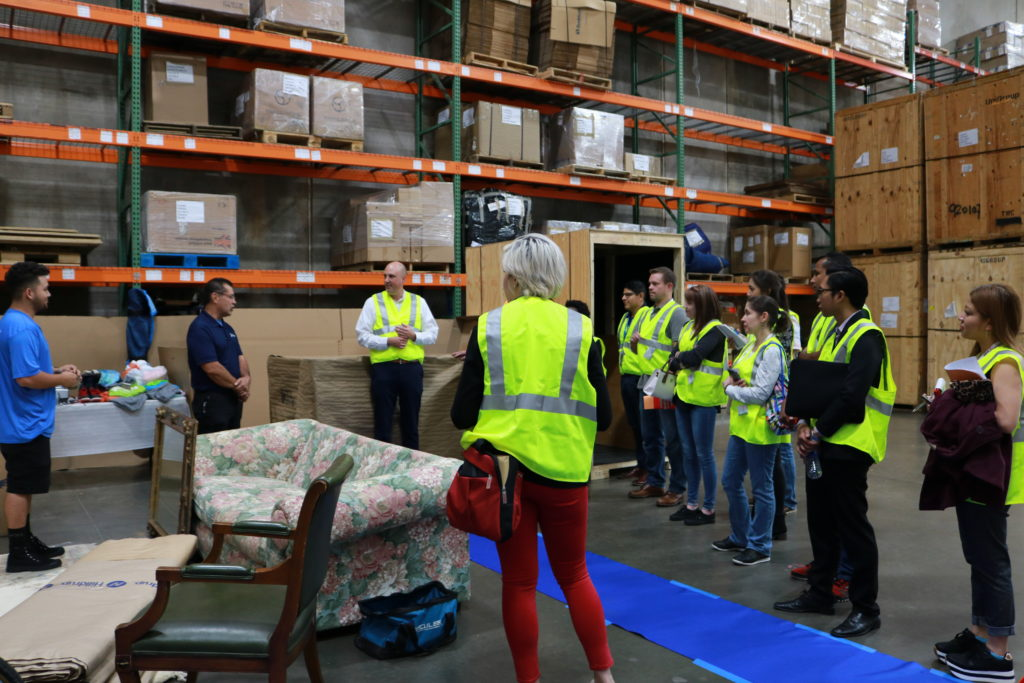 FIDI students listen to instructions during warehouse tour