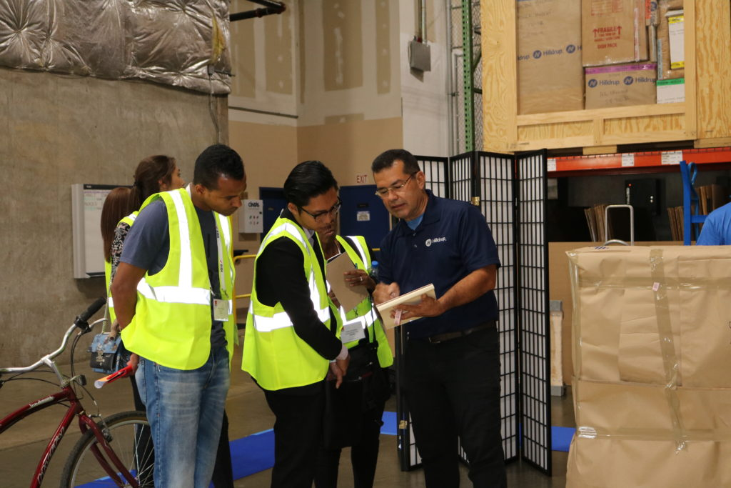 FIDI students learn how to pack and label items