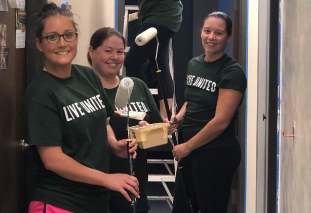 Hilldrup employees participate in United Way event painting hallway