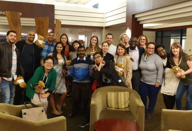 FIDI students standing together in hotel lobby