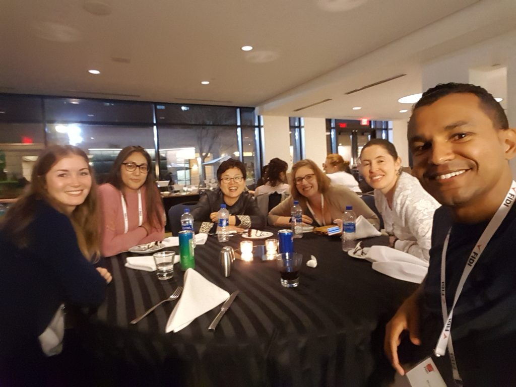 FIDI students work together at a table at hotel