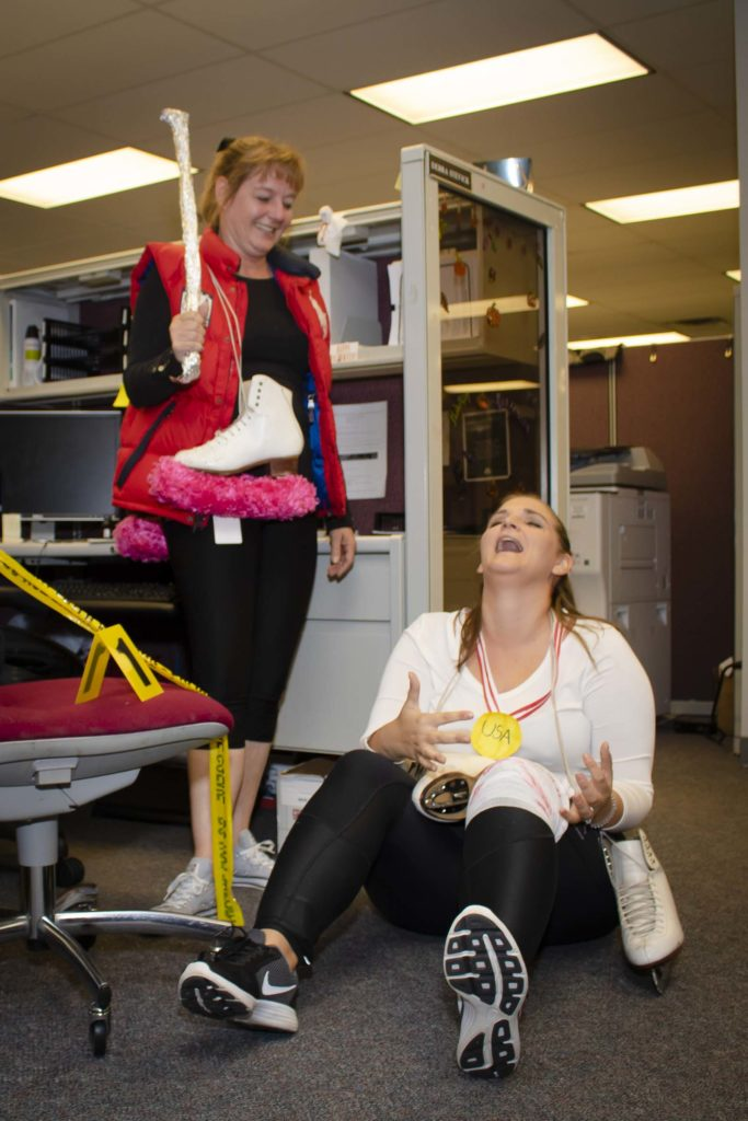 Hilldrup employees dressed as Tonya Harding and Nancy Kerrigan