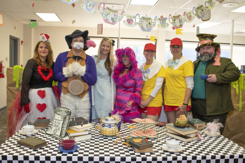 Hilldrup employees dressed as characters from Alice in Wonderland