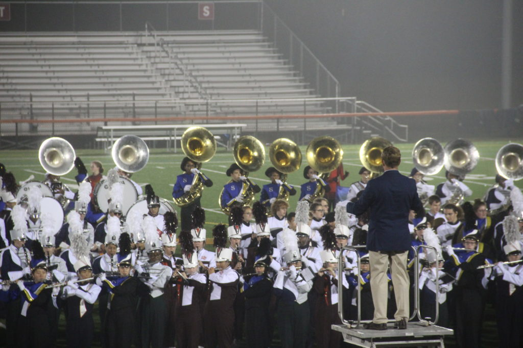 High school band plays on the football field