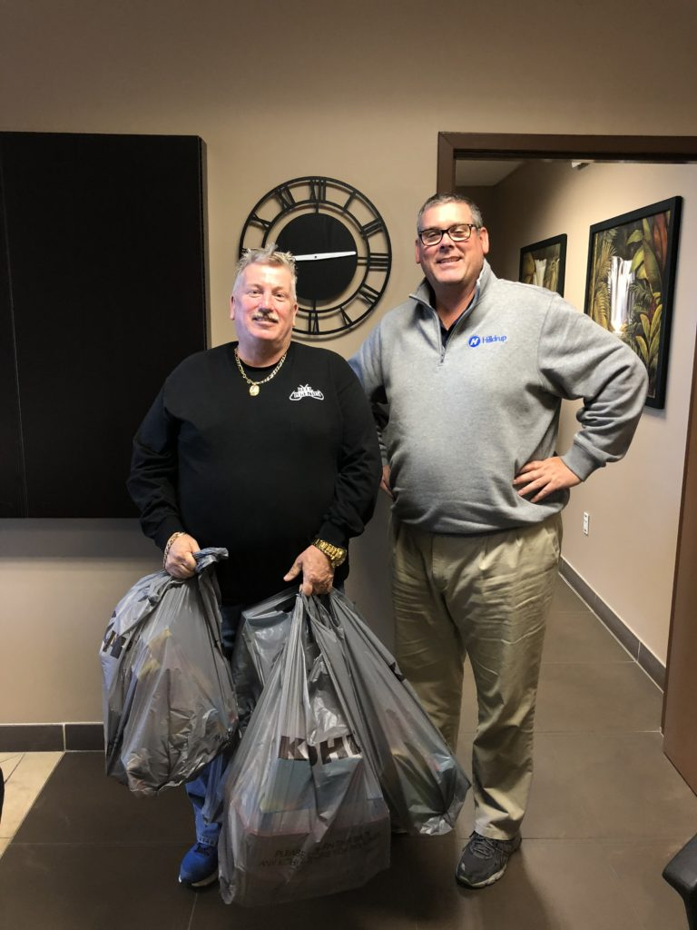 Tom Reilly prepares to deliver bags of Christmas gifts to children