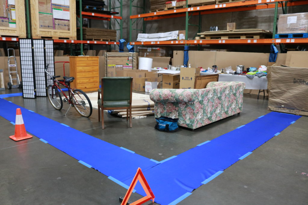 A packing demonstration is set up in a warehouse