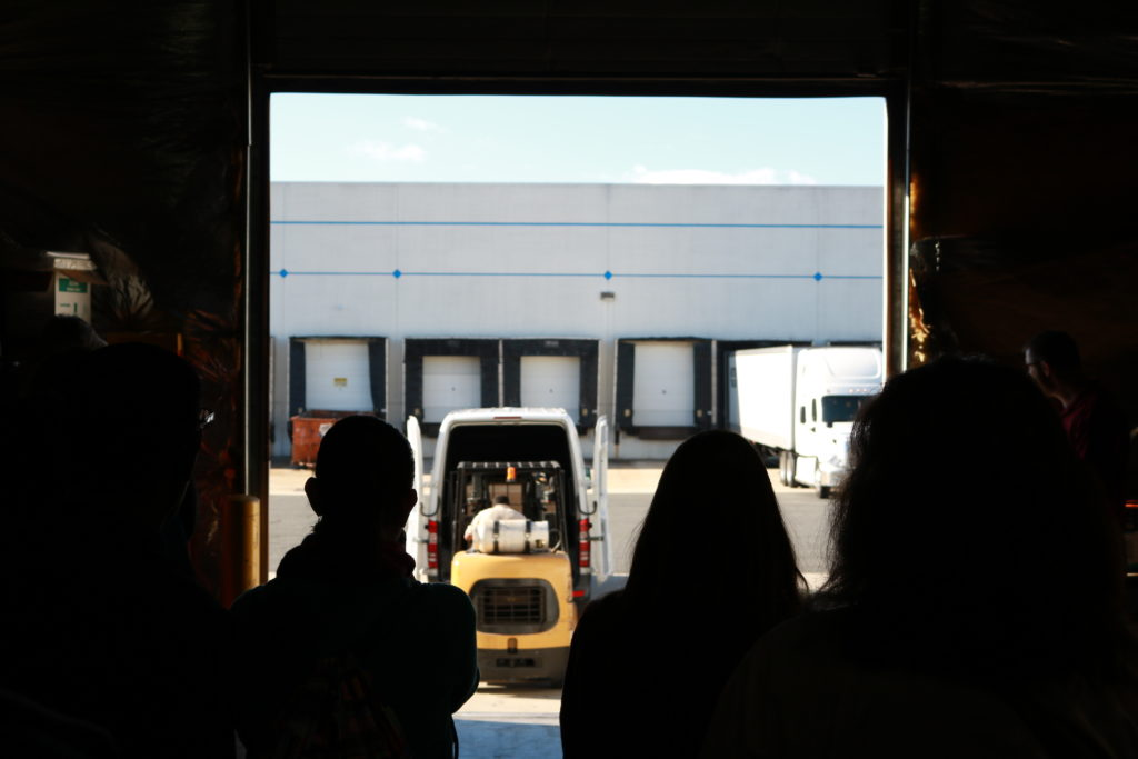 Students watch a shipment be delivered