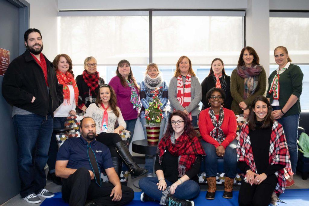 Hilldrup Stafford team wears festive scarves/ties.