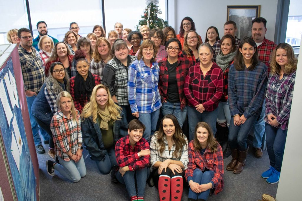 Team Hilldrup wears flannel together
