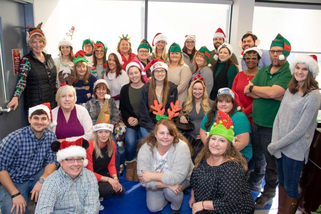 Hilldrup team wears festive hats for Christmas season