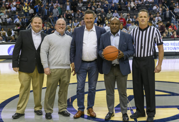 Hilldrup team members at center court at Georgetown Basketball game
