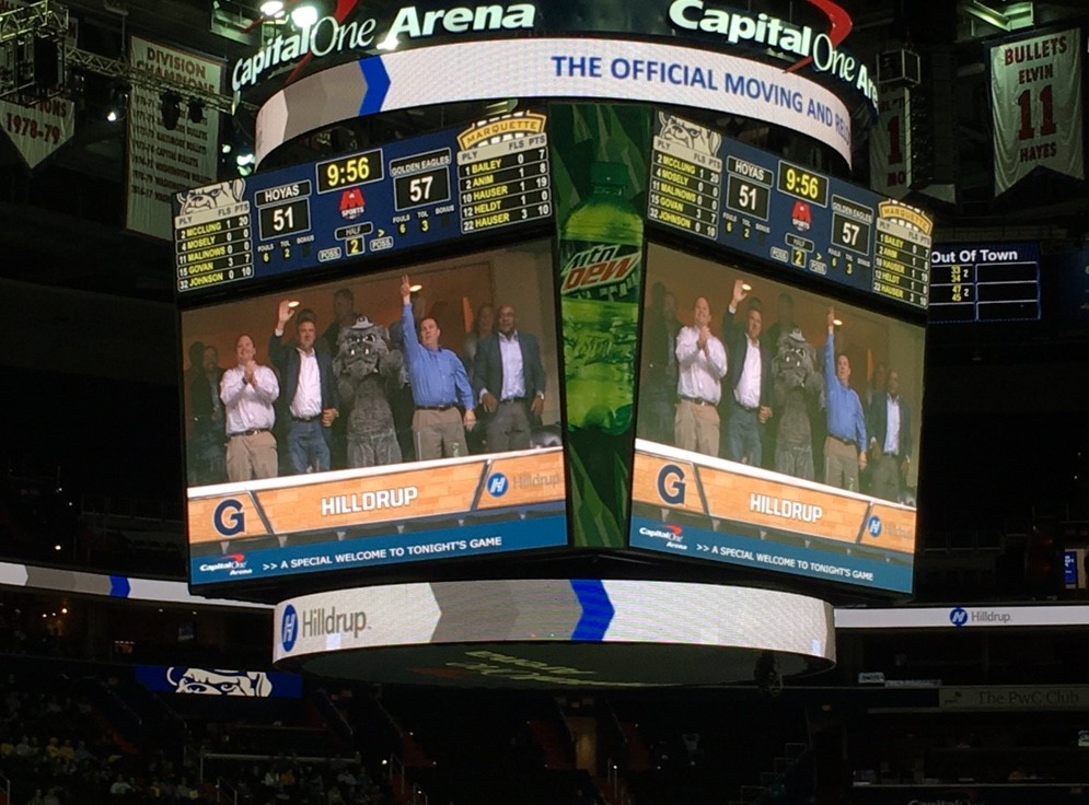 Hilldrup Commercial team with Georgetown mascot highlighted on a big screen