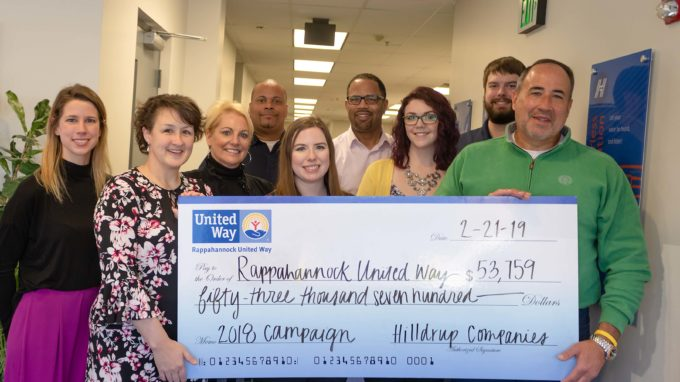 Charles W McDaniel and Hilldrup leaders posing with check of $53,000 for Rappahannock United Way