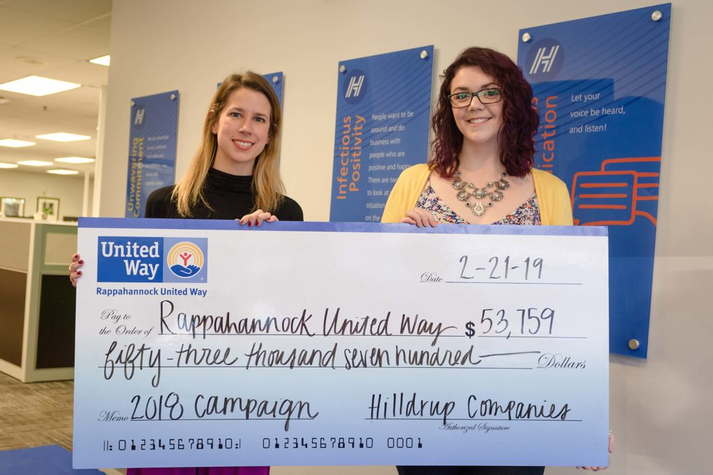 Grace Draper and Amanda Strawn posing with check of $53,000 for Rappahannock United Way
