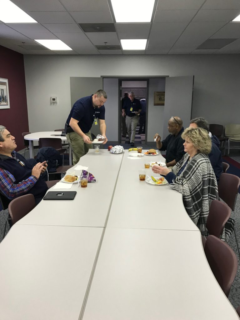 Greenville team enjoys a luncheon with one another