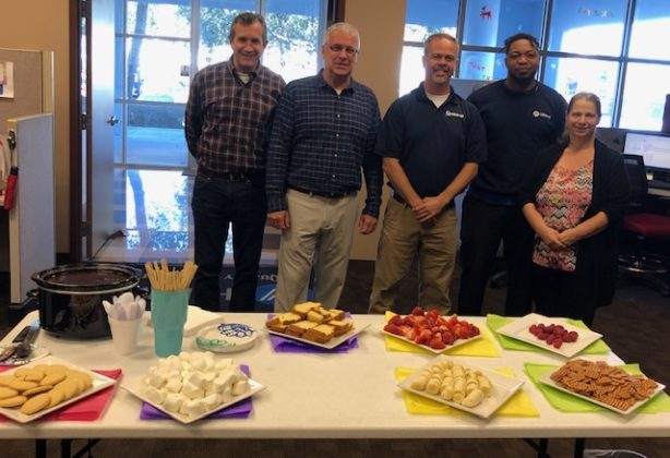 Hilldrup Orlando team with sweets on a table