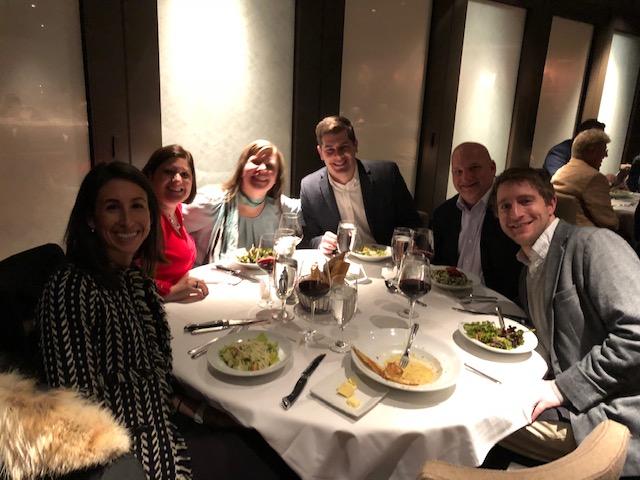 Professionals enjoy a meal together