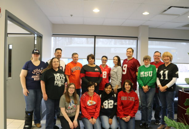 Hilldrup employees sporting their favorite sports teams