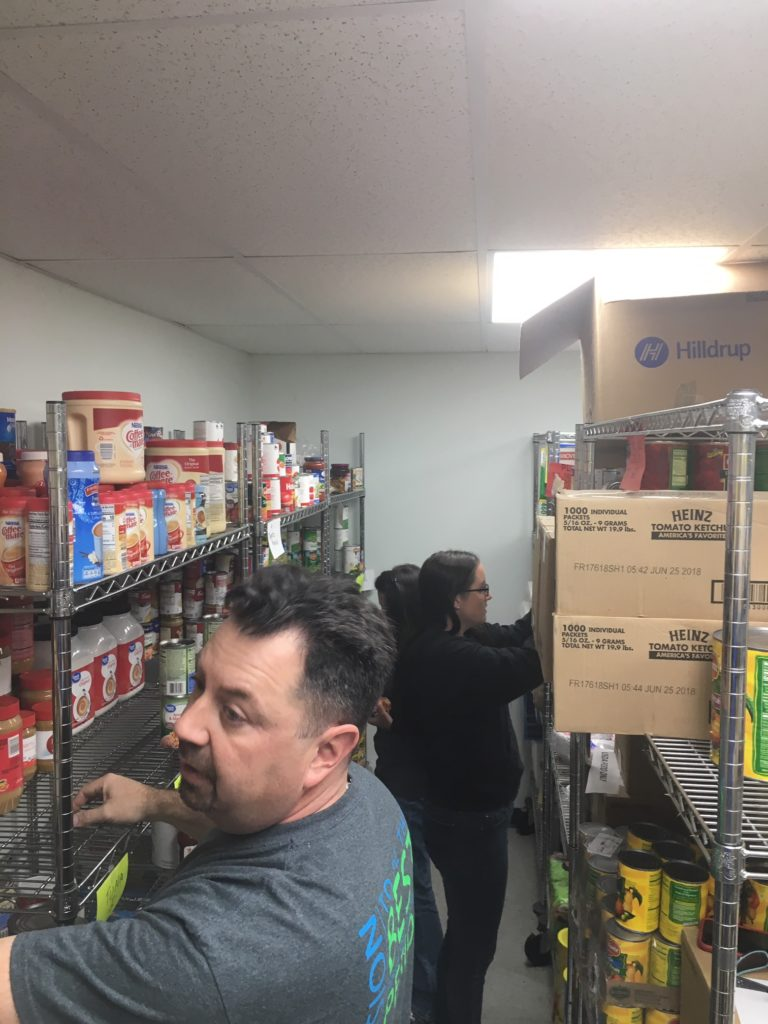 Hilldrup employees organizing inventory in a pantry