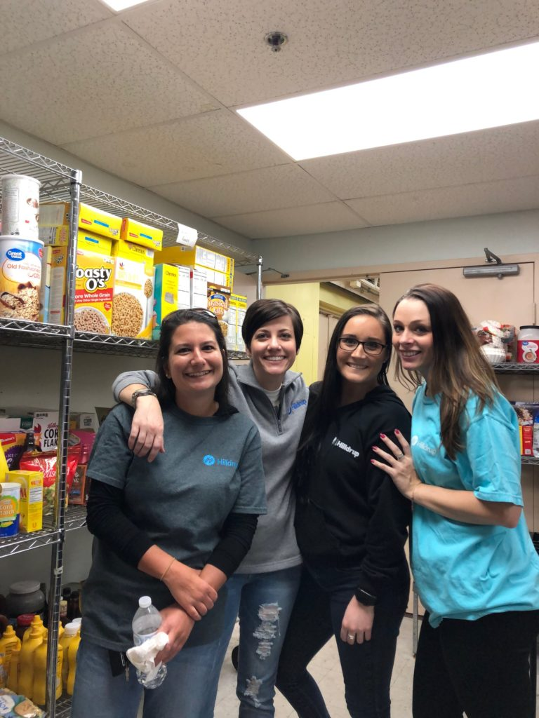 4 Hilldrup ladies at the food pantry of the homeless shelter