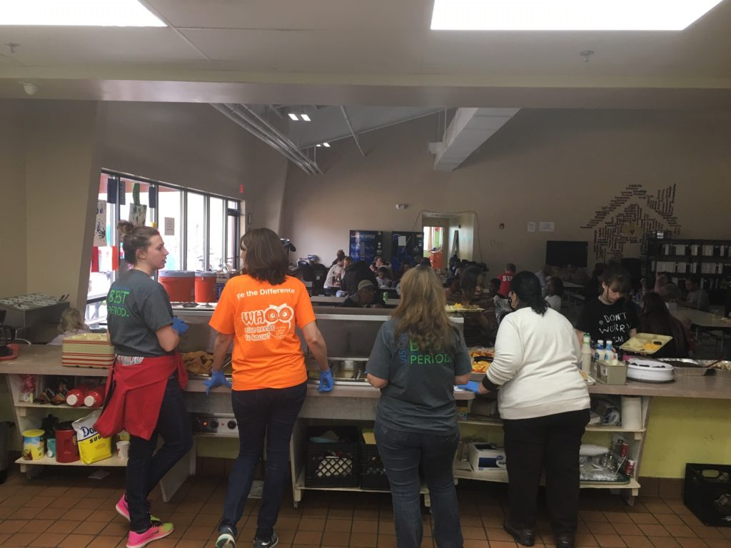 Hilldrup employees preparing to serve food at a homeless shelter