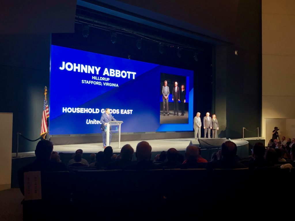 Johnny Abbott being presented with award at UniGroup's 2019 Learning Conference