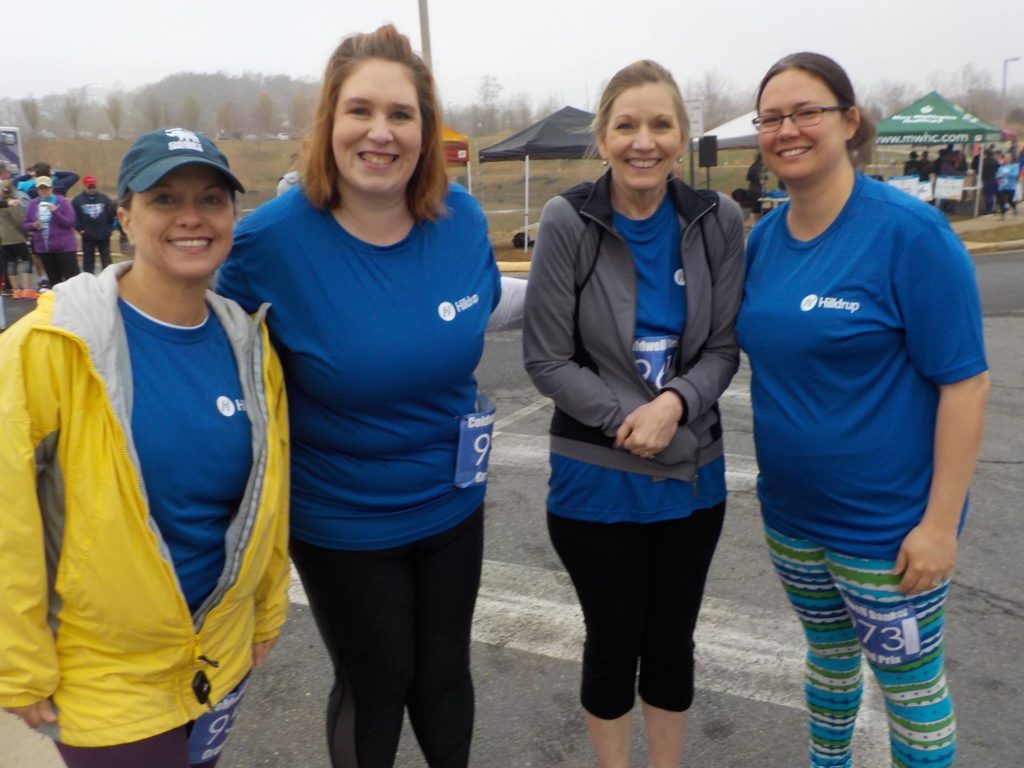 Group photo of Hilldrup employees at 5k outside in the cold