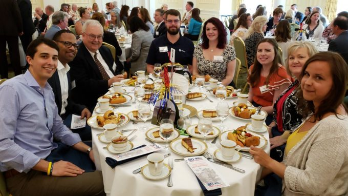 Charlie McDaniel and other Hilldrup employees enjoying a meal at the 2018 campaign celebration