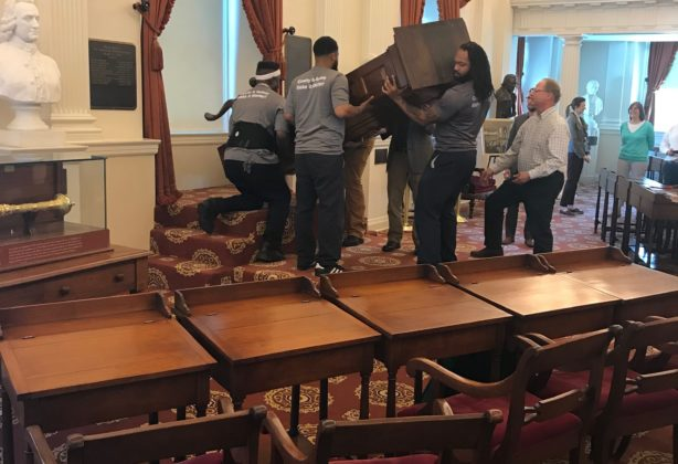 Hilldrup movers carefully standing up the speakers chair