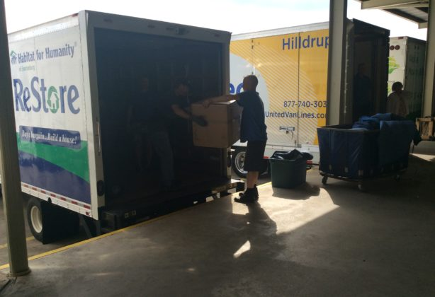 Hilldrup movers loading boxes into a moving truck