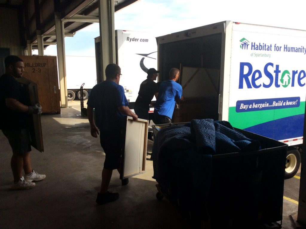 Hilldrup movers loading picture frames into a moving truck