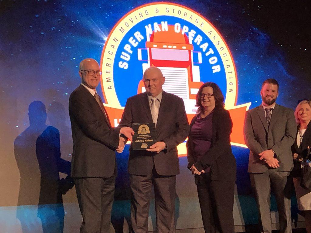 Johnny Abbott handing over award to Hilldrup executive