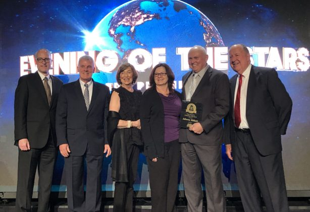 Charles G. McDaniel and other members of the leadership team receiving award at the AMSA's 100th Annual Education Conference and Expo from Johnny Abbott