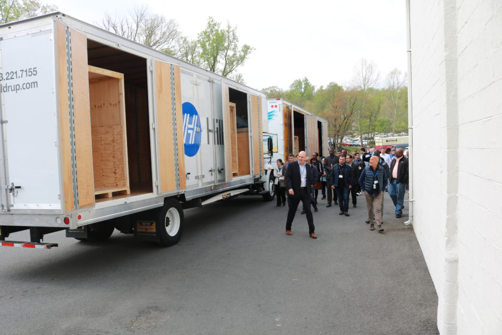 Stafford's employees showing the Department of State's transportation division the inside of moving trucks