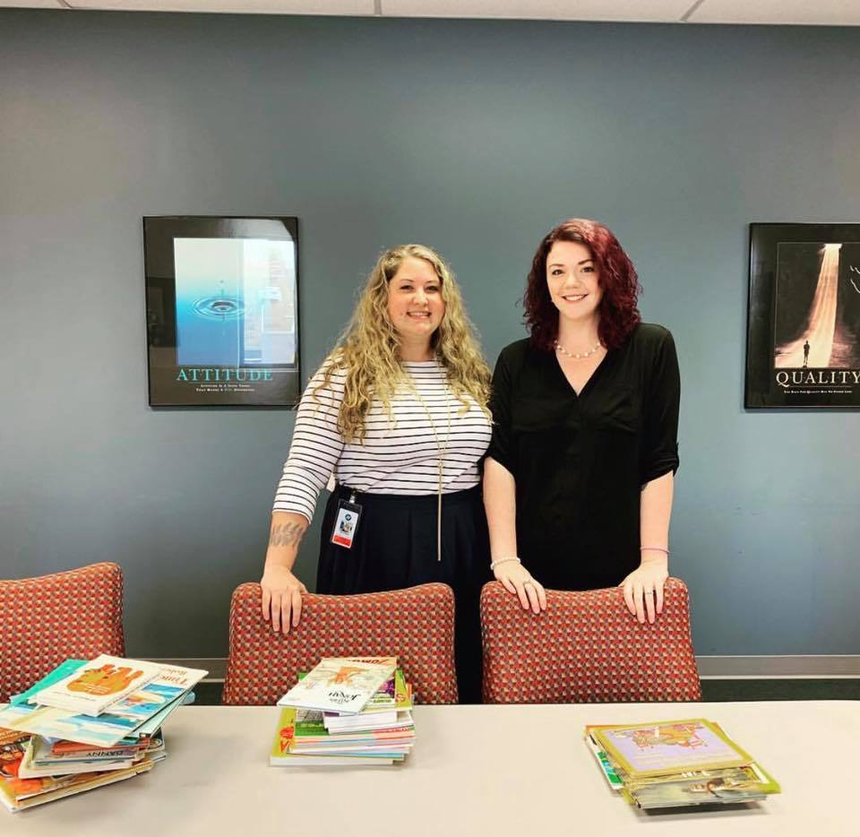 Amanda Strawn with an RUW Rep during Hilldrup's book drive