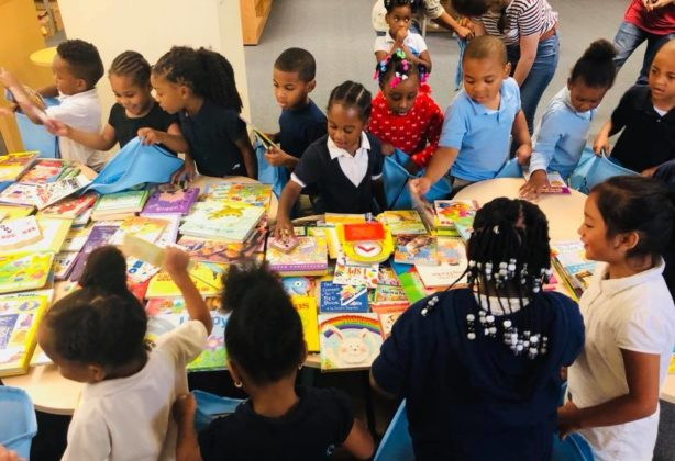 Children picking books at Charles Nonprofit, promising pages