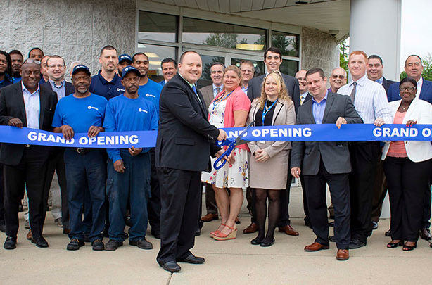Matt Dodson cutting grand opening ribbon at the Capitol Heights location in Maryland