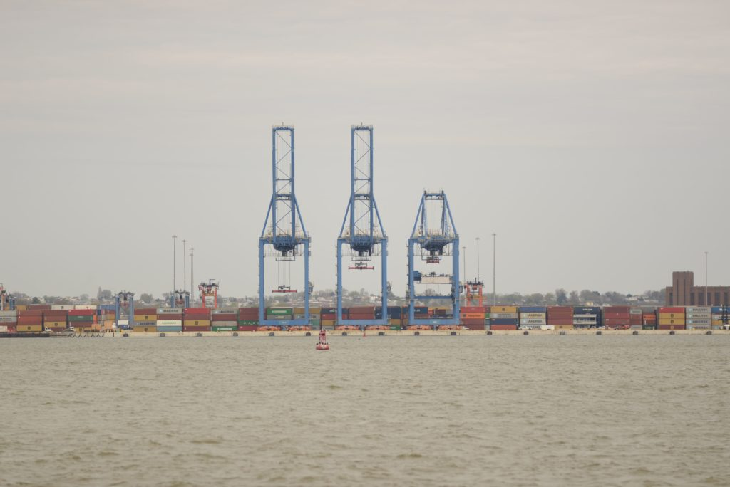 Tall shipping container cranes at cargo port in Baltimore